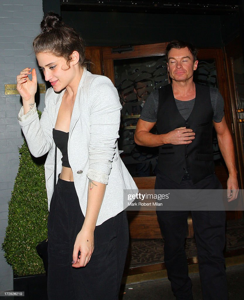 Katie Waissel and Greg Burns leaving the Groucho club on July 2, 2013 in London, England.