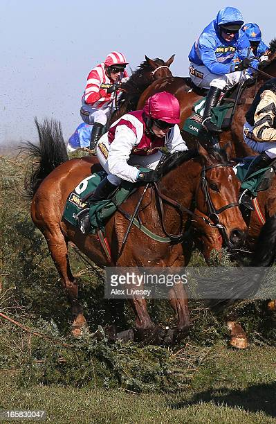 Katie Walsh riding Seabass jumps the chair during the John Smiths Grand National Steeple Chase at Aintree Racecourse on April 6 2013 in Liverpool...