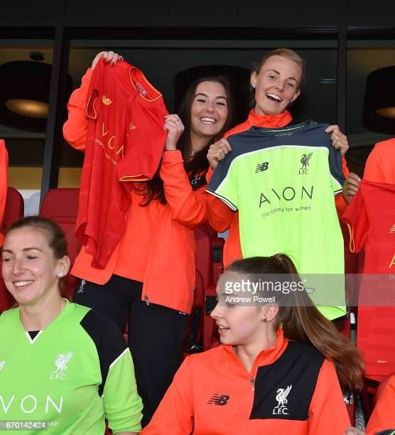 Katie Zelem and Sophie Ingle of Liverpool Ladies show off their new shirt sponsor Avon at Anfield on April 18 2017 in Liverpool England