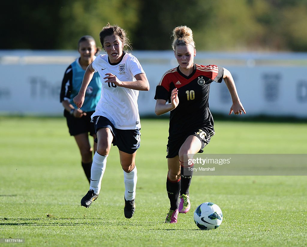 Katie Zelem of England persues Janina Meissner of Germany during the Women's International Friendly match between England Under 19 Women and Germany Under 19 Women at St George's Park on September 22, 2013 in Burton upon Trent, England.