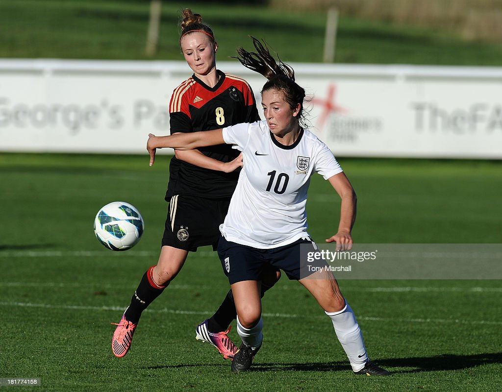 Katie Zelem of England tackled by Judith Steinert of Germany during the Women's International Friendly match between England Under 19 Women and Germany Under 19 Women at St George's Park on September 22, 2013 in Burton upon Trent, England.