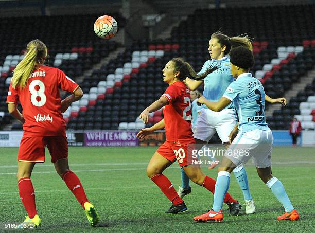Katie Zelem of Liverpool Ladies and Abbie McManus and Demi Stokes of Manchester City Women in action during the Liverpool Ladies v Manchester City...
