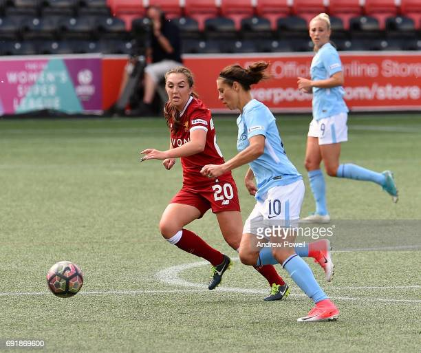 Katie Zelem of Liverpool Ladies competes with Carli Lloyd of Manchester City Women during a WSL 1 match between Liverpool Ladies and Manchester City...