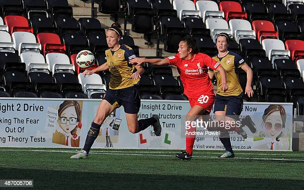 Katie Zelem of Liverpool Ladies competes with Casey Stoney of Arsenal Ladies FC during the Womens Super League match between Liverpool Ladies and...