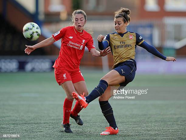 Katie Zelem of Liverpool Ladies competes with Jemma Rose of Arsenal Ladies FC during the Womens Super League match between Liverpool Ladies and...