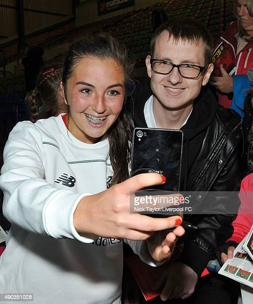 Katie Zelem of Liverpool Ladies poses for a photo with a fan after the Liverpool Ladies v Chelsea Ladies WSL game at Select Security Stadium on...