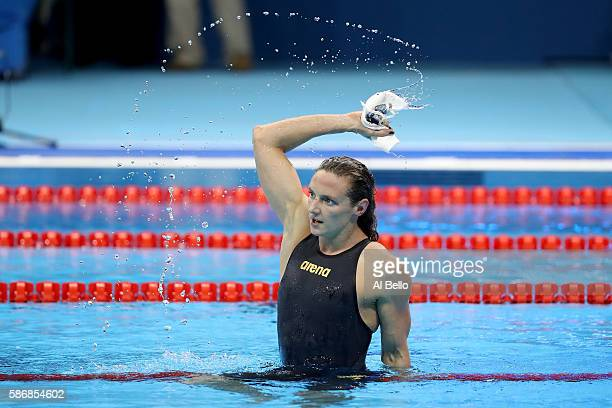 Katinka Hosszu of Hungary celebrates winning gold and a new world record in the Final of the Women's 400m Individual Medley on Day 1 of the Rio 2016...