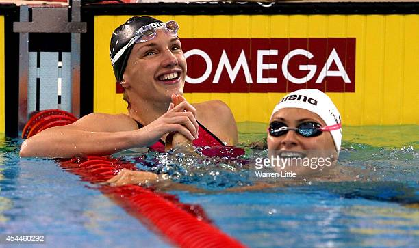 Katinka Hosszu of Hungary celebrates winning the Women's 100m Individual Medley in a World Record time of 5686 seconds during day two of the FINA...