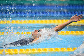 Katinka Hosszu of Hungary competes in Women's 100m Backstroke during the FINA Swimming World Cup 2015 at Tokyo Tatsumi International Swimming Pool on...