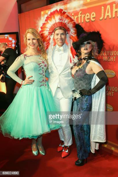 Katja Burkard Jens Hilbert and Tina Ruland attend the Hollywood Superhero Fairytale Night hosted on November 26 2016 in Darmstadt Germany