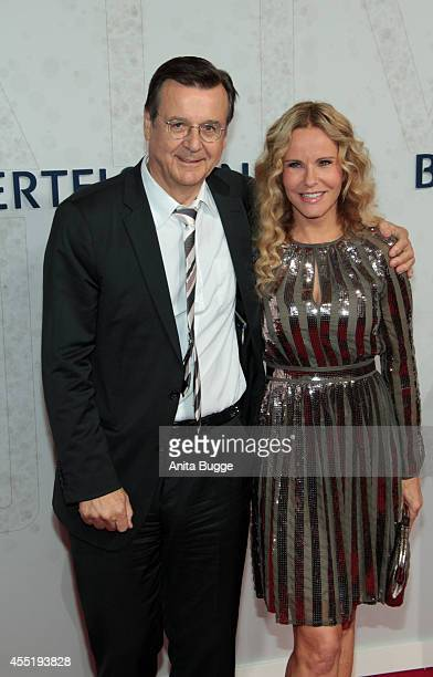 Katja Burkhard and Hans Mahr attend the Bertelsmann Summer Party at the Bertelsmann representative office on September 10 2014 in Berlin Germany