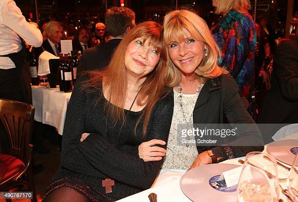Katja Ebstein and Lena Valaitis during Ralph Siegel's 70th birthday party at Schuhbeck's Teatro on September 30 2015 in Munich Germany