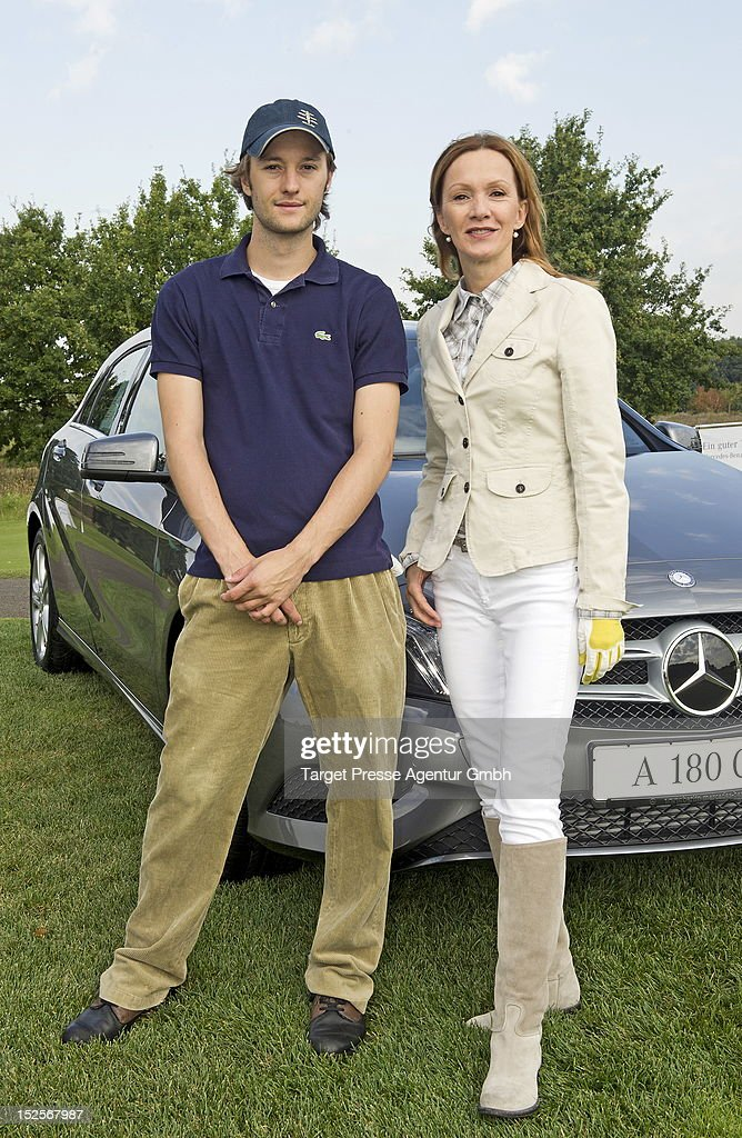 Katja Flint and her son Oscar Lauterbach attend the 13th MercedesBenz Charity Cup to benefit the 'Deutsches Herzzentrum Berlin' on September 22 2012...
