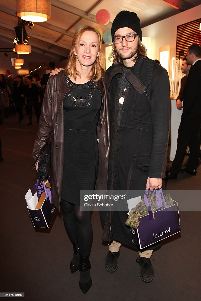 Katja Flint and her son Oscar Lauterbach attend the Laurel show during the MercedesBenz Fashion Week Berlin Autumn/Winter 2015/16 at Brandenburg Gate...