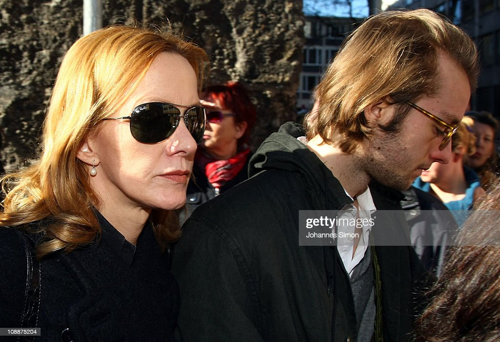 Katja Flint and her son Oscar Lauterbach attend the memorial service for Bernd Eichinger at the St Michael Kirche on February 07 2011 in Munich...
