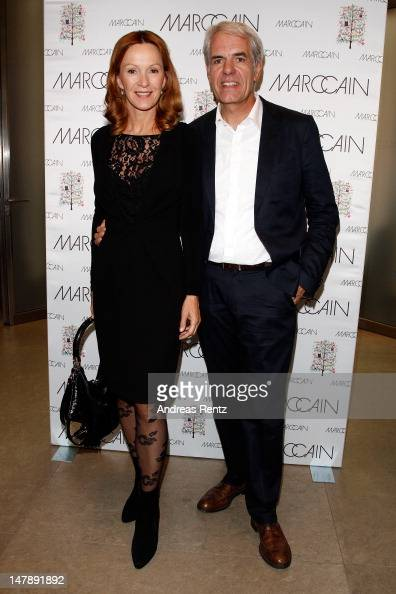 Katja Flint and Norbert Lock arrive for the Marc Cain show during the MercedesBenz Fashion Week Spring/Summer 2013 on July 5 2012 in Berlin Germany