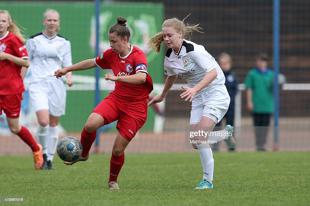 Katja Friedl of Potsdam battles for the ball with Ina Teltenkoetter of Guetersloh during the U17 Girl's Bundesliga semi final first leg match between...