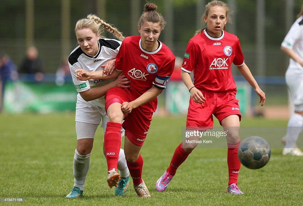 Katja Friedl of Potsdam battles for the ball with Nina Lange of Guetersloh during the U17 Girl's Bundesliga semi final first leg match between...