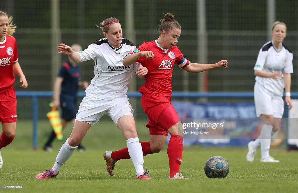 Katja Friedl of Potsdam battles for the ball with Nina Neumann of Guetersloh during the U17 Girl's Bundesliga semi final first leg match between...