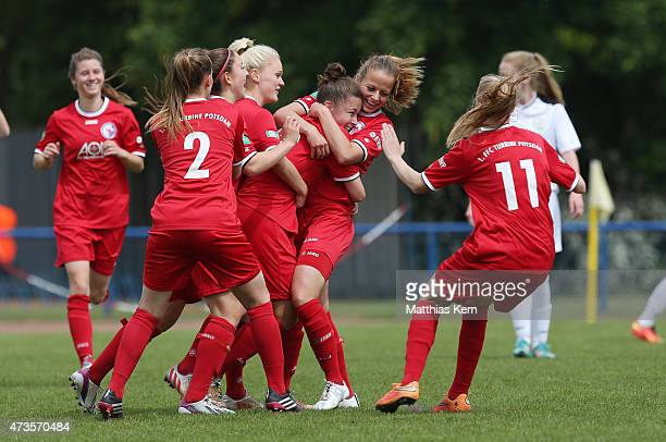 Katja Friedl of Potsdam jubilates with team mates after scoring the first goal during the U17 Girl's Bundesliga semi final first leg match between...