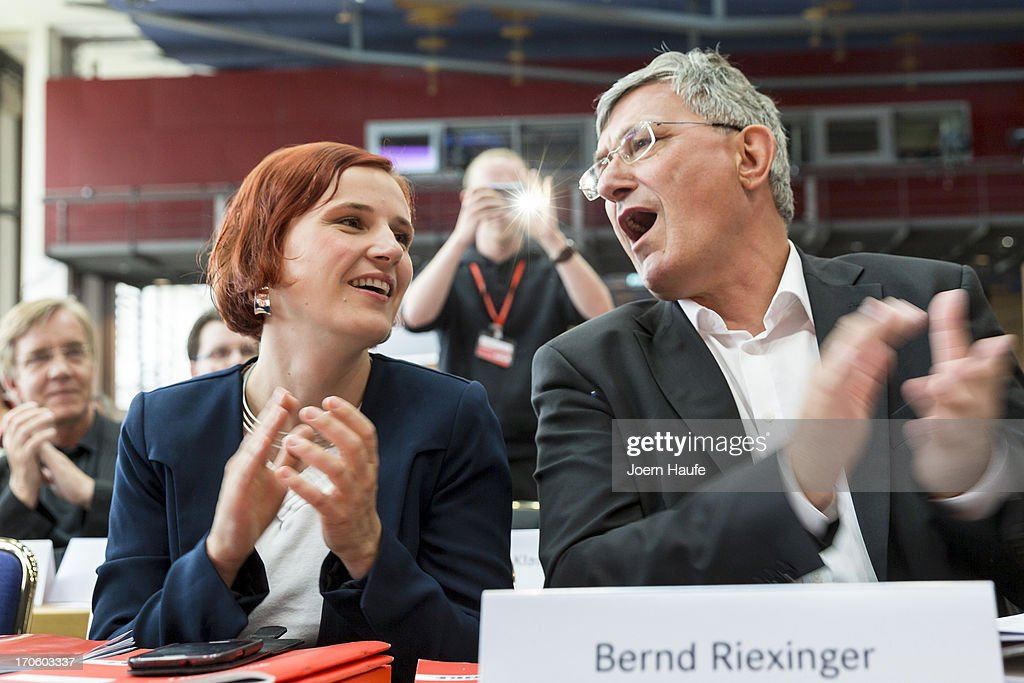 Katja Kipping, co-Chairwoman of the left-wing Die Linke political party, and Bernd Riexinger, Leader of the left-wing Die Linke political party, applaud during the party's federal convention on June 15, 2013 in Dresden, Germany. Die Linke, Germany's main left-wing political party, are meeting to decide on their policy program for German federal elections scheduled for September.