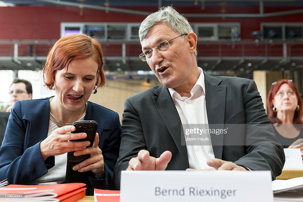Katja Kipping, co-Chairwoman of the left-wing Die Linke political party, and Bernd Riexinger, Leader of the left-wing Die Linke political party, speak with one another during the party's federal convention on June 15, 2013 in Dresden, Germany. Die Linke, Germany's main left-wing political party, are meeting to decide on their policy program for German federal elections scheduled for September.