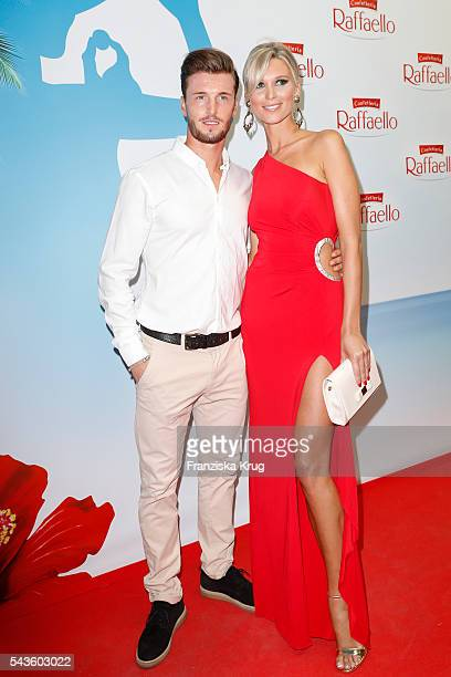 Katja Kuehne and her boyfriend soccer player Quirin Moll attend the Raffaello Summer Day 2016 to celebrate the 26th anniversary of Raffaello on June...