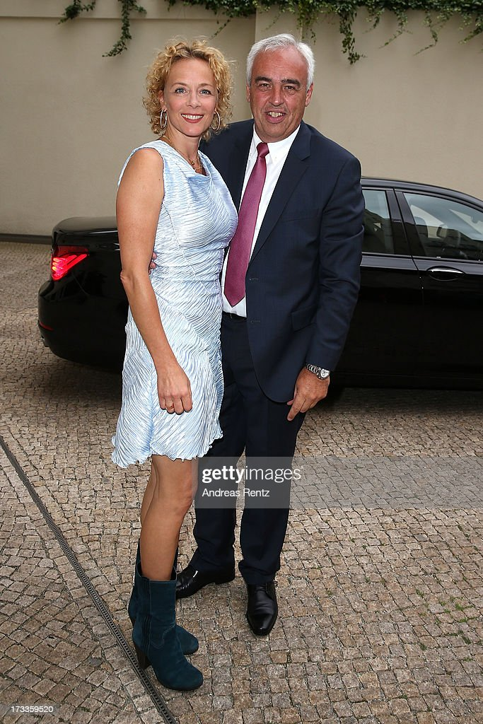 Katja Riemann and Hans-Rainer Schroeder arrive for the Cinema for Peace UN women honorary dinner at Soho House on July 12, 2013 in Berlin, Germany.
