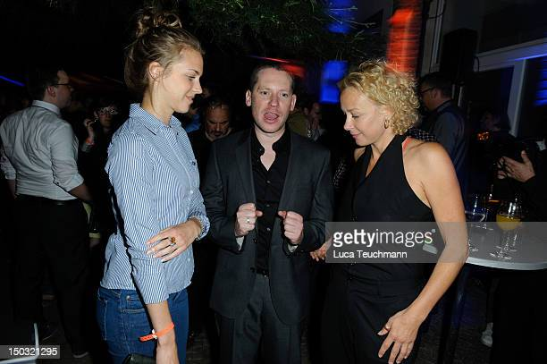 Katja Riemann Marco Kreuzpaintner and Paula Riemann attend the 'flimmerde' launch party at Kunztschule on August 15 2012 in Berlin Germany