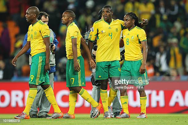 Katlego Mphela Bernard Parker Aaron Mokoena and Siphiwe Tshabalala of South Africa leave the pitch after the 2010 FIFA World Cup South Africa Group A...