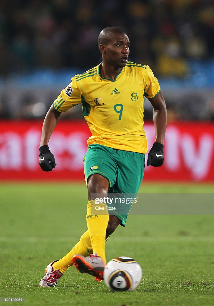 <a gi-track='captionPersonalityLinkClicked' href=/galleries/search?phrase=Katlego+Mphela&family=editorial&specificpeople=4501352 ng-click='$event.stopPropagation()'>Katlego Mphela</a> of South Africa runs with the ball during the 2010 FIFA World Cup South Africa Group A match between South Africa and Uruguay at Loftus Versfeld Stadium on June 16, 2010 in Tshwane/Pretoria, South Africa.