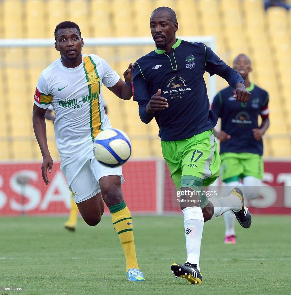 <a gi-track='captionPersonalityLinkClicked' href=/galleries/search?phrase=Katlego+Mphela&family=editorial&specificpeople=4501352 ng-click='$event.stopPropagation()'>Katlego Mphela</a> of Sundowns and Benson Mhlongo of Paltinum Stars compete for the ball during the Absa Premiership match between Platinum Stars and Mamelodi Sundowns from Royal Bafokeng Stadium on March 30, 2013 in Rustenburg, South Africa.