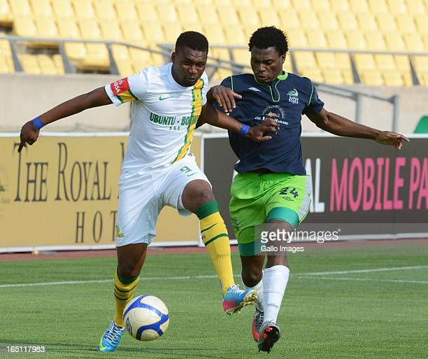 Katlego Mphela of Sundowns and Enocent Mkhabela of the Stars compete for the ball during the Absa Premiership match between Platinum Stars and...