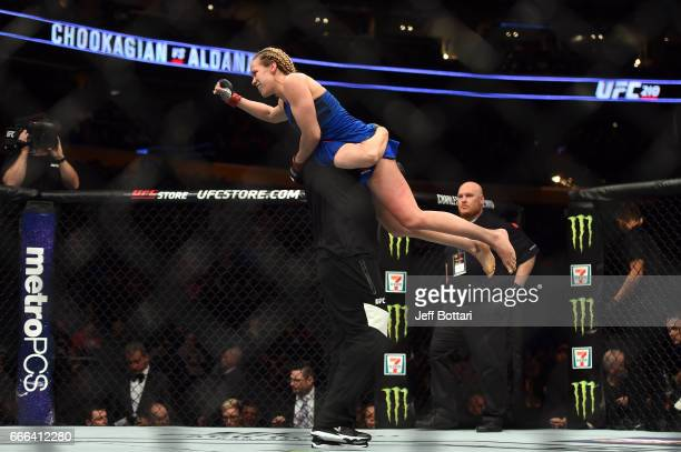 Katlyn Chookagian celebrates with her corner after facing Irene Aldana of Mexico in their women's bantamweight bout during the UFC 210 event at the...