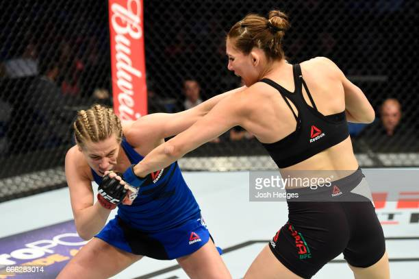 Katlyn Chookagian fends off Irene Aldana of Mexico in their women's bantamweight bout during the UFC 210 event at KeyBank Center on April 8 2017 in...