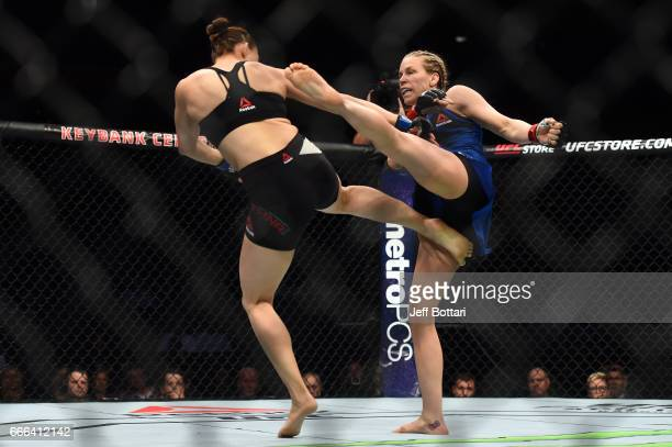 Katlyn Chookagian kicks Irene Aldana of Mexico in their women's bantamweight bout during the UFC 210 event at the KeyBank Center on April 8 2017 in...
