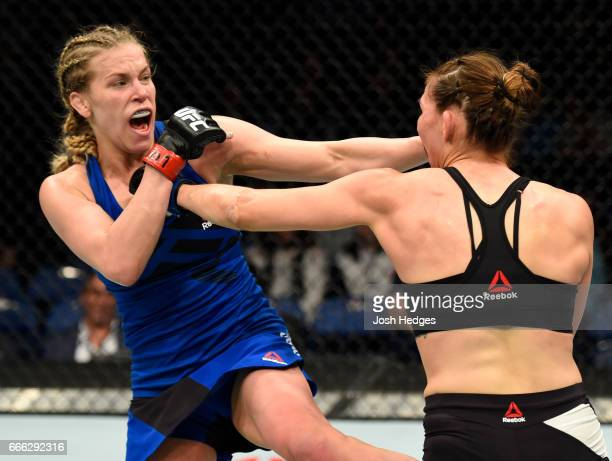 Katlyn Chookagian mixes it up with Irene Aldana of Mexico in their women's bantamweight bout during the UFC 210 event at KeyBank Center on April 8...