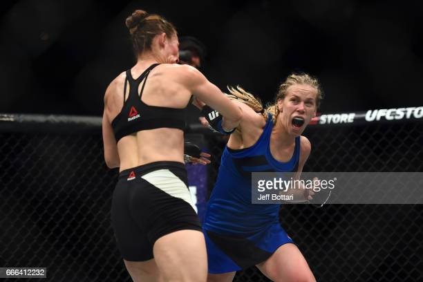 Katlyn Chookagian punches Irene Aldana of Mexico in their women's bantamweight bout during the UFC 210 event at the KeyBank Center on April 8 2017 in...