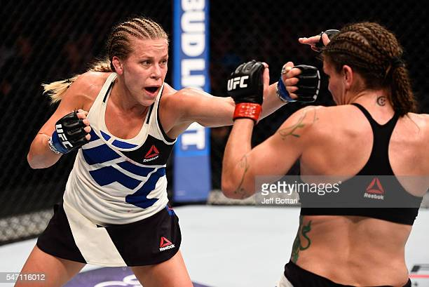 Katlyn Chookagian punches Lauren Murphy in their women's bantamweight bout during the UFC Fight Night event on July 13 2016 at Denny Sanford Premier...