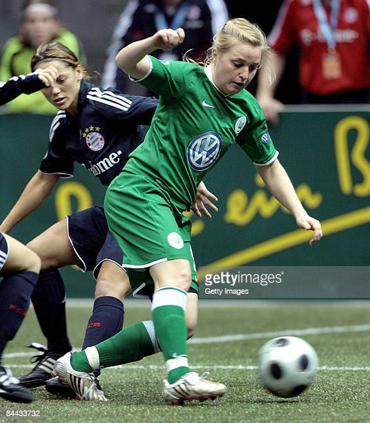 Katri NoskoKoivisto of VfL 1945 Wolfsburg in action against Bianca Rech of FC Bayern Muenchen during the THome DFB Indoor Cup at the Boerdelandhalle...