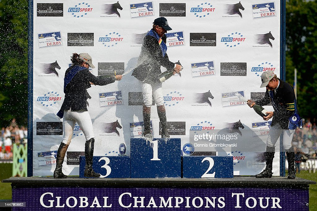Katrin Eckermann (3rd place) of Germany, <a gi-track='captionPersonalityLinkClicked' href=/galleries/search?phrase=Nick+Skelton&family=editorial&specificpeople=227134 ng-click='$event.stopPropagation()'>Nick Skelton</a> (1st place) of Great Britain and Rolf-Goeran Bengtsson (2nd place) of Sweden celebrate at the podium after the CSI5 Global Champions Tour Grand Prix of Hamburg during day three of the German Jumping & Dressage Grand Prix 2012 at Klein Flottbek on May 19, 2012 in Hamburg, Germany.