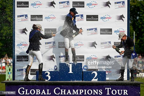 Katrin Eckermann of Germany Nick Skelton of Great Britain and RolfGoeran Bengtsson of Sweden celebrate at the podium after the CSI5 Global Champions...