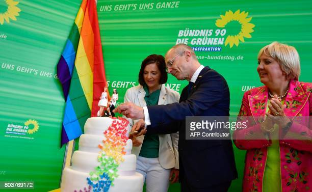 Katrin GoeringEckardt parliamentary group leader of the Greens and MP of the Greens Volker Beck cut a wedding cake in rainbow colors and decorated...