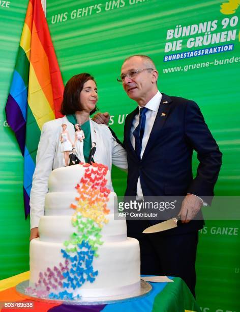 Katrin GoeringEckardt parliamentary group leader of the Greens and MP of the Greens Volker Beck prepare to cut a wedding cake in rainbow colors and...