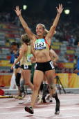 Katrin Green of Germany celebrates after winning the gold medal in the Women's 200m T44 final Athletics event at the National Stadium during day...