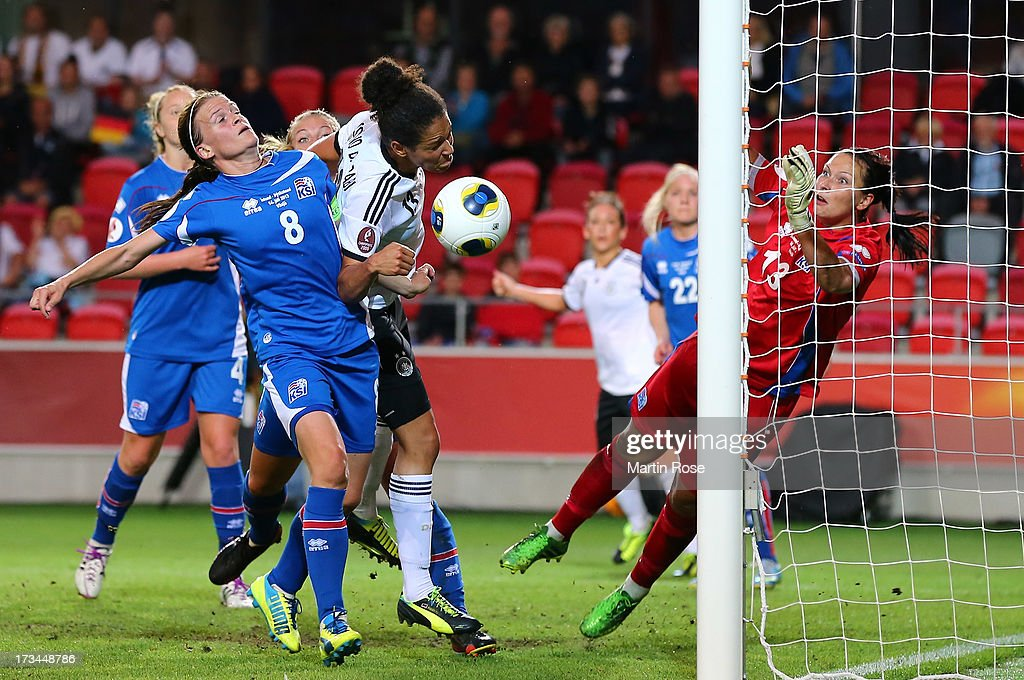 Katrin Jonsdottir (L) of Iceland and Celia Okoyino Da Mbabi (C) of Germany battle for the ball during the UEFA Women's Euro 2013 group B match between Iceland and Germany at Vaxjo Arena on July 14, 2013 in Vaxjo, Sweden.