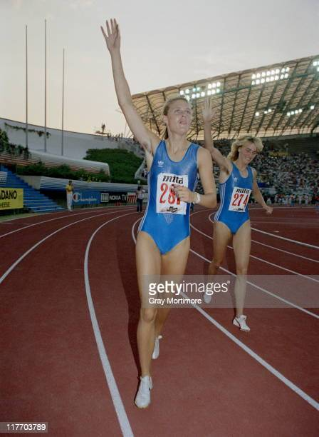 Katrin Krabbe of East Germany celebrates winning the Women's 200 metres with compatriot second placed Heike Drechsler at the 15th European Athletics...