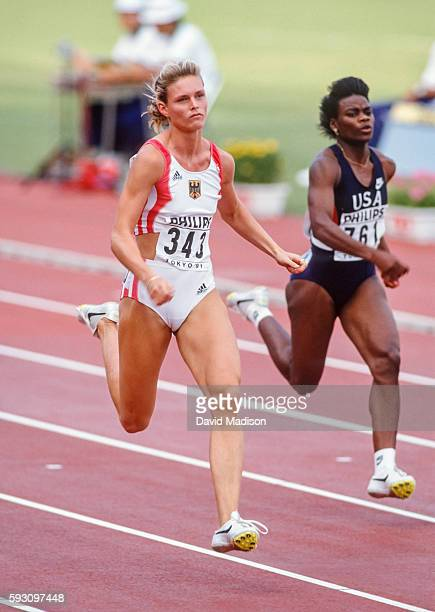 Katrin Krabbe of Germany and Carlette Guidry of the USA run the 100 meter event of the 1991 IAAF World Championships during August 1991 at the...