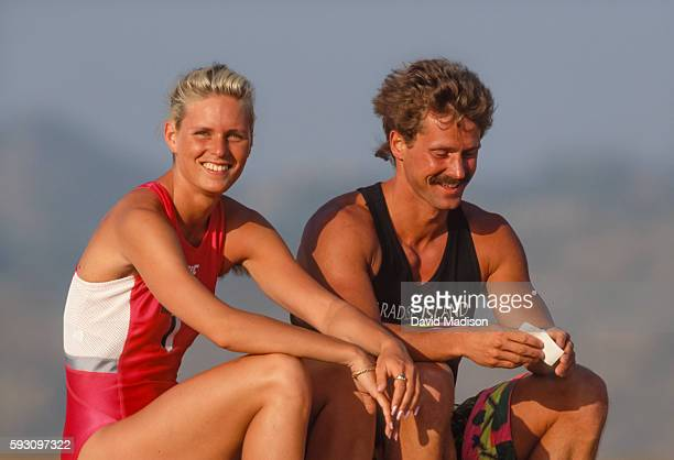 Katrin Krabbe of Germany sits with her coach Thomas Springsteen during a photo session while training in June 1991 near San Diego California