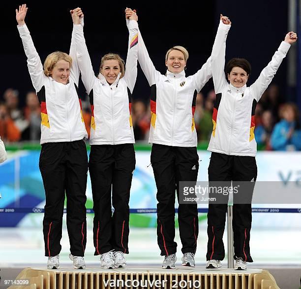 Katrin Mattscherodt Anni FriesingerPostma Stephanie Beckert and Daniela Anschutz Thoms of Germany celebrate winning the gold medal during the flower...